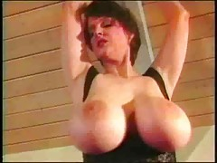 Brunette milf with huge hooters