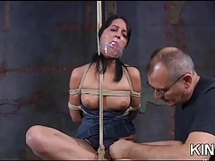 Hogtied brunette in bondage