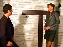 Mature Woman Getting Tied To Cross Spanked With Stick Gettin...