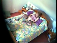Mom fingering in bed watching a porno